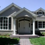 Front at entry with barrel ceiling in the porch, and roof eave moldings