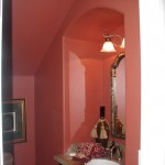Powder room under stairs.