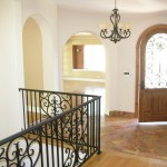 Entry hall. The stairs go down to a game room and garage.