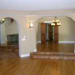 Living room looking back to the entry and dining room.