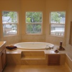 Master Bath tub sits in a bay window with a fireplace